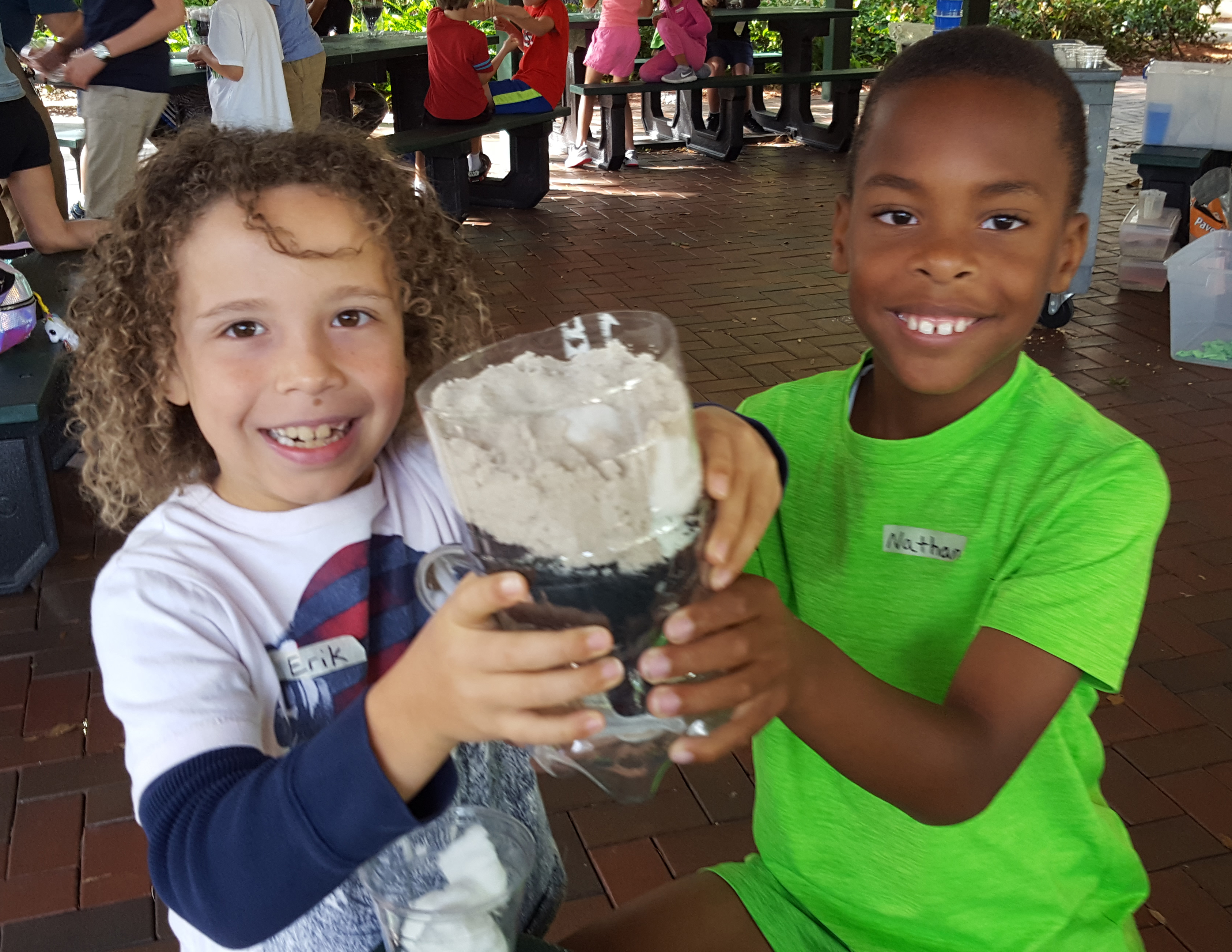 Two boys show off a science creation