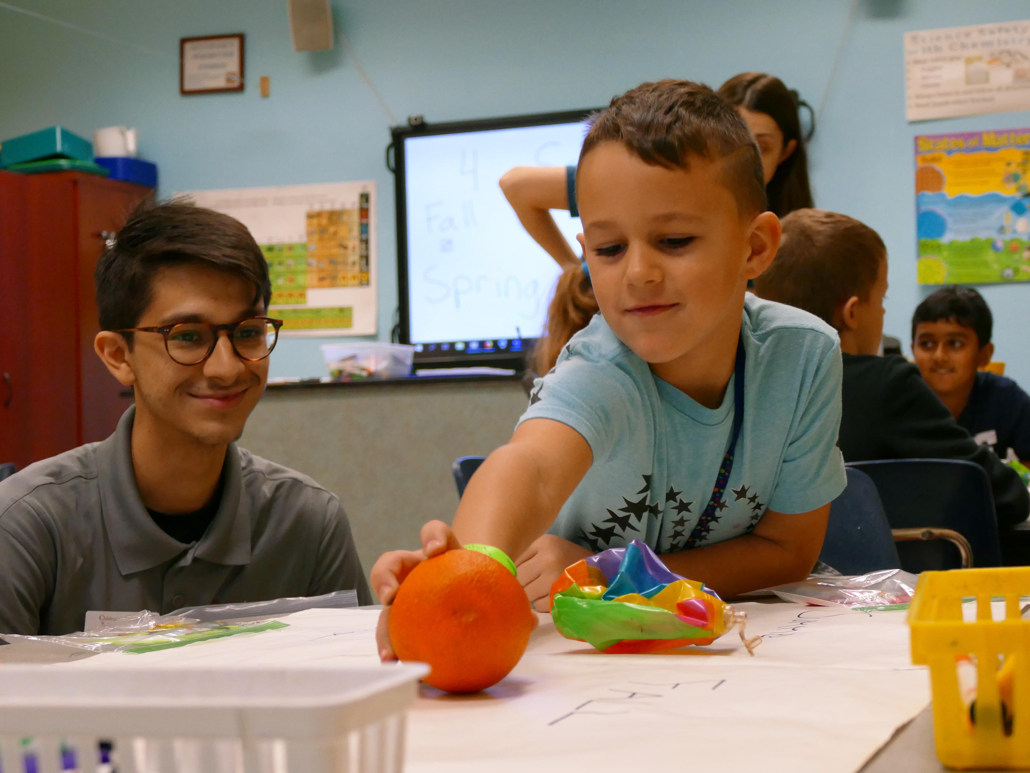 kid with orange