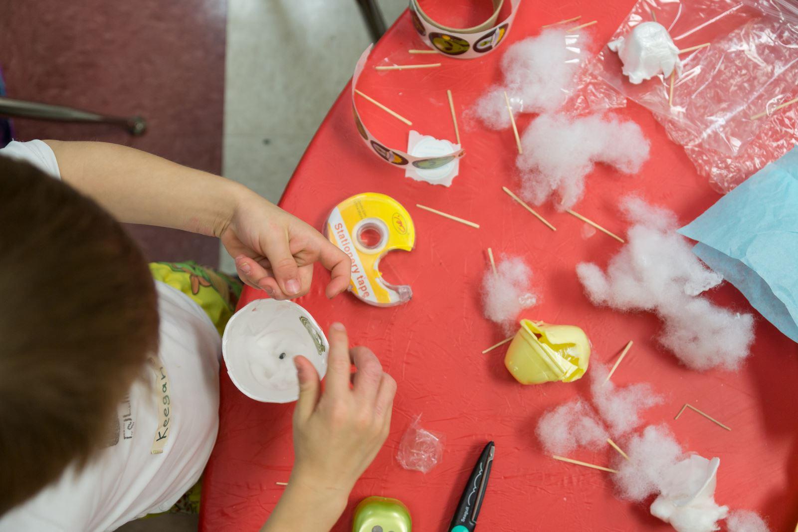 child doing crafts