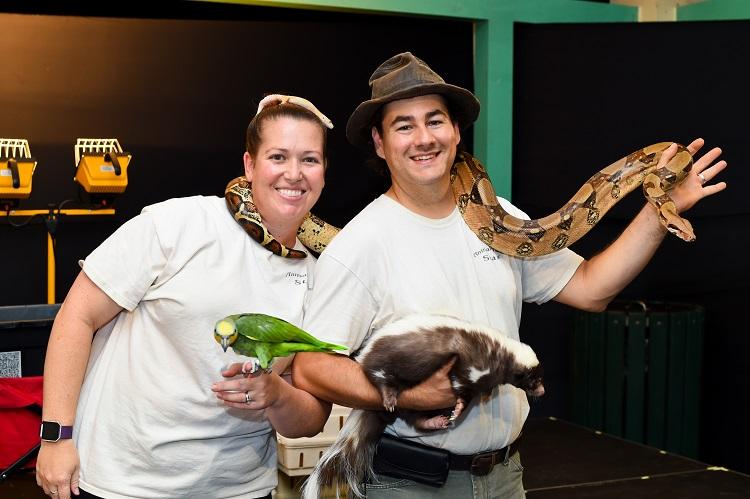 couple holding snake